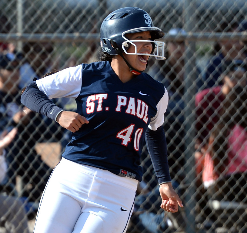 . St. Paul\'s Bryanna Campos (#40) cheers after scoring as they play Bishop Amat in their Del Rey League girls softball game at York Field in Whittier on Thursday March 27, 2014. St. Paul defeated Bishop Amat 7-5. (Staff Photo by Keith Durflinger/Whittier Daily News)