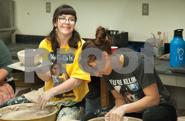 01/10/18 Wesley Bunnell | Staff Volunteers gathered at CCSU on Wednesday evening to throw clay for bowls which will eventually be decorated and sold to benefit the Friendship Center's soup kitchen in an event called the Souper Bowl. Ally Rusgrove holds up a bowl for a volunteer to take away.