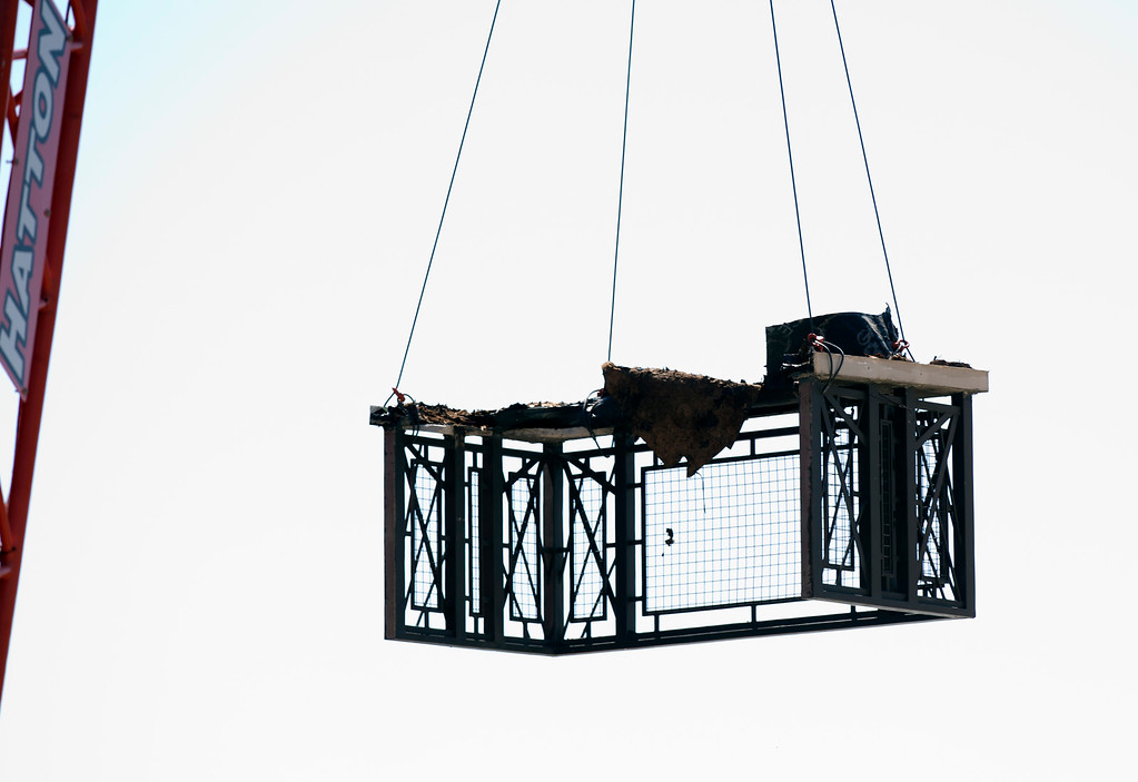 . A crane lowers the remnants of a fifth-floor balcony that collapsed, sending 13 people plunging to the street below, Tuesday, June 16, 2015, in Berkeley, Calif. Six people were killed and seven more were transported to area hospitals. (D. Ross Cameron/Bay Area News Group)