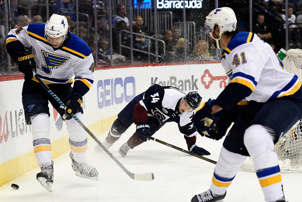 . DENVER, CO - APRIL 03: Carl Soderberg (34) of the Colorado Avalanche loses his balance as Carl Gunnarsson (4) of the St. Louis Blues and Robert Bortuzzo (41) take control of the puck during the first period. The Colorado Avalanche hosted the St. Louis Blues at the Pepsi Center on Sunday, April 3, 2016. (Photo by AAron Ontiveroz/The Denver Post)