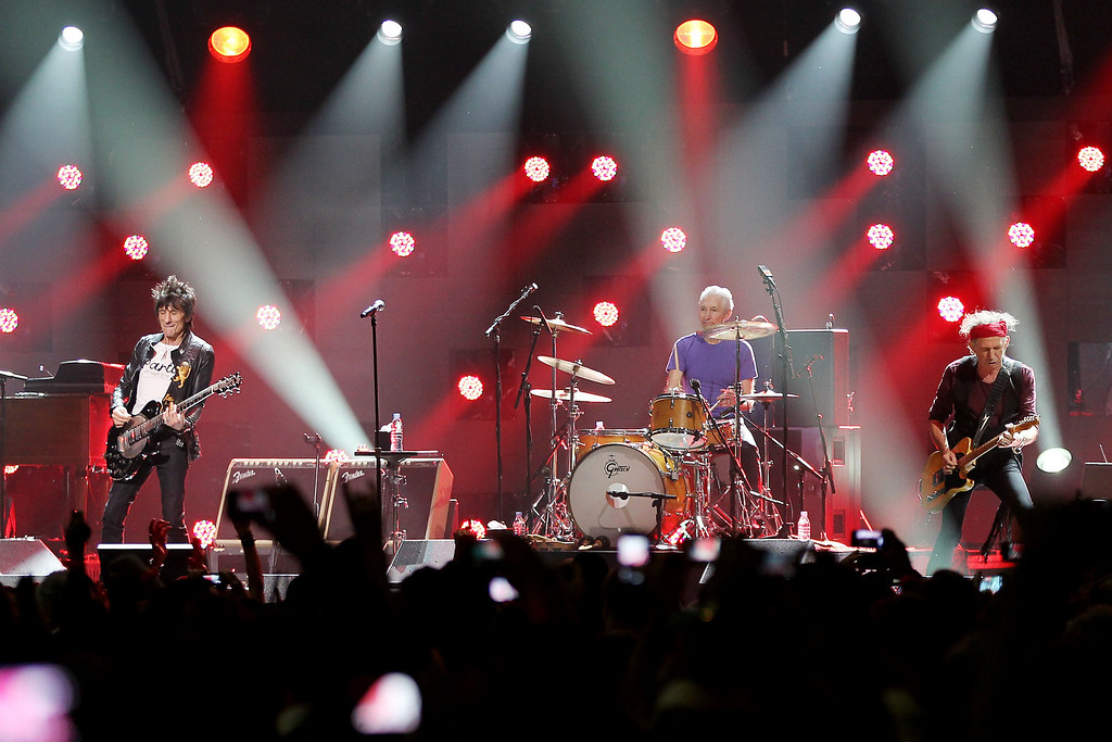 . This image released by Starpix shows Ron Wood, from left, Charlie Watts, and Keith Richards of The Rolling Stones performing at the 12-12-12 The Concert for Sandy Relief at Madison Square Garden in New York on Wednesday, Dec. 12, 2012. Proceeds from the show will be distributed through the Robin Hood Foundation. (AP Photo/Starpix, Dave Allocca)