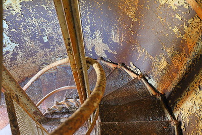 Rusty stairs inside Cape Charles Lighthouse. I visited in September and was swarmed by mosquitoes even with a thick coating of DEET bug spray and can only imagine how those stationed at the light must have suffered.  Smith Island, Eastern Shore, VA. © 2020 Kenneth R. Sheide