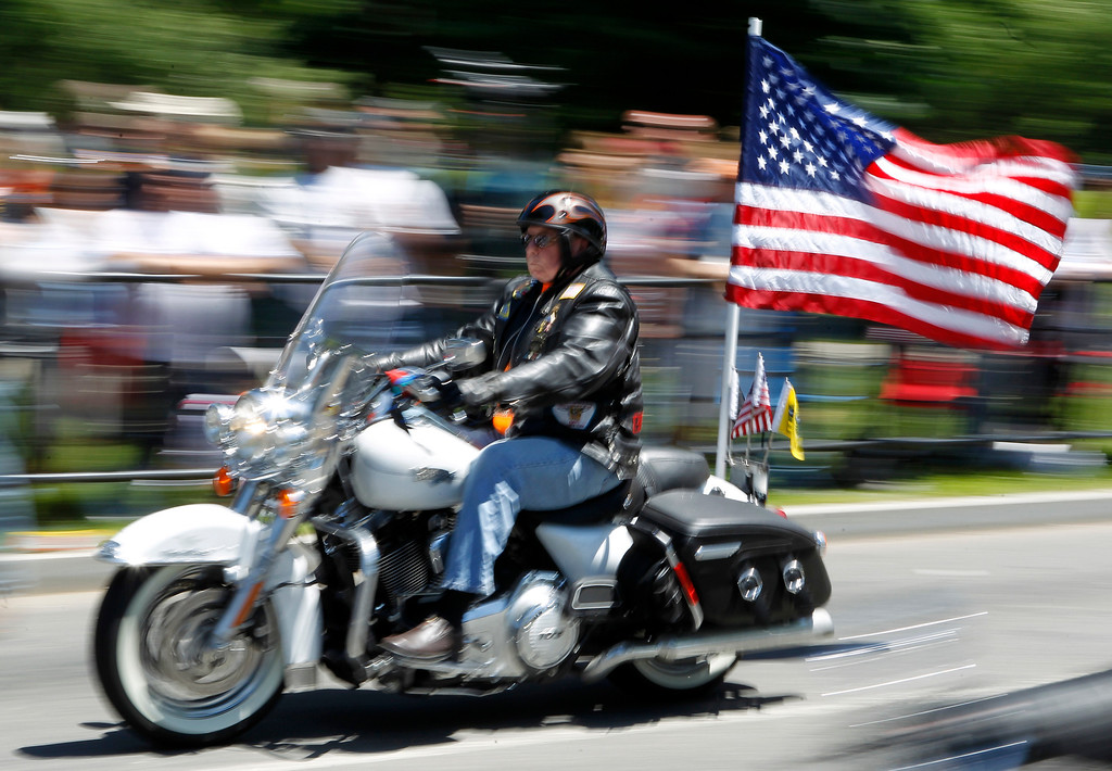 ". A motorcycle participates in the annual Rolling Thunder ""Ride for Freedom\"" ahead of Memorial Day in Washington, Sunday, May 26, 2013. (AP Photo/Molly Riley)"