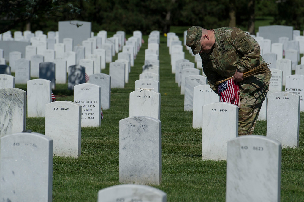 . Army Chief of Staff Gen. Mark Alexander Milley places flags at gravesite as the Army 3d U.S. Infantry Regiment, The Old Guard, honor the nation\'s fallen military heroes during its annual Flags In ceremony at Arlington National Cemetery, May 24, 2018. (AP Photo/Cliff Owen)