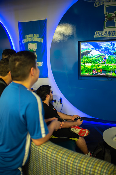 Islander students play video game in breakers game room in the university center.
