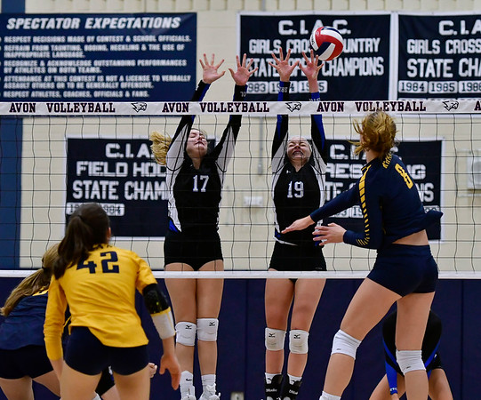 11/1/2018 Mike Orazzi | Staff Bristol Eastern's Gabriella Nozzolillo (17) and Amber Blais (19) at the net with RHAM's Kaylin Hadley (8) during the CCC Volleyball Tournament at Avon High School Thursday night.