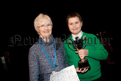 Adjucator Elizabeth Bicker is pictured with Mikolaj Chmura from St Patricks PS Drumgreenagh who won the Silver CHallenge Cup in the Boys Solo for P6 & P7. R1510003
