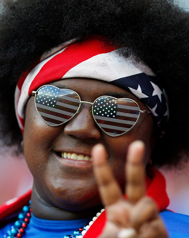 . A USA supporter gives the peace sign before the group G World Cup soccer match between the United States and Portugal at the Arena da Amazonia in Manaus, Brazil, Sunday, June 22, 2014. (AP Photo/Julio Cortez)