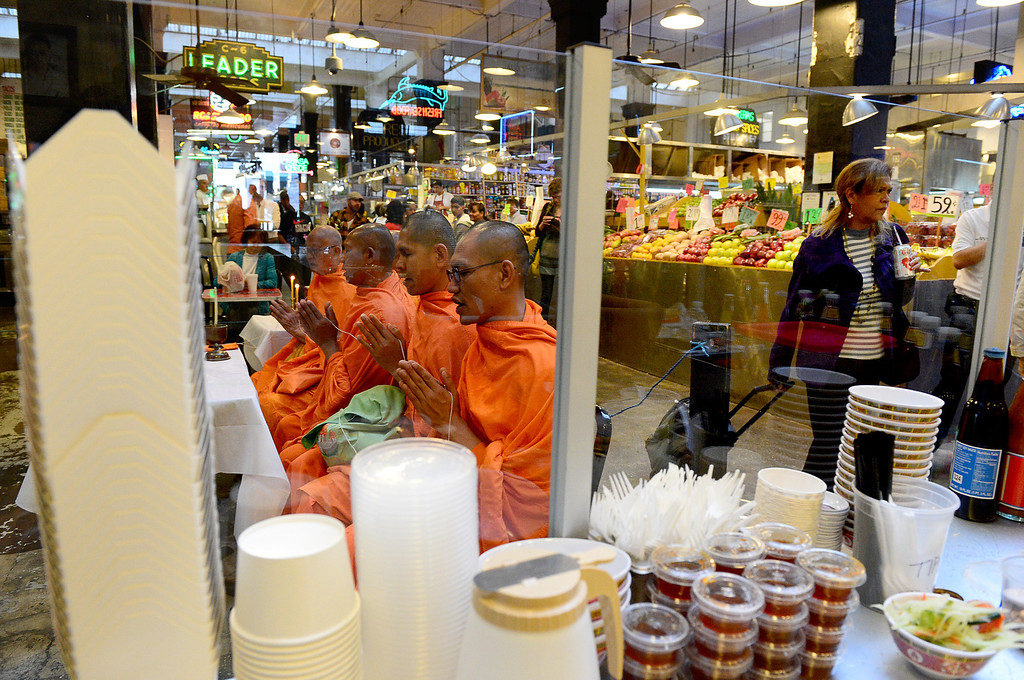. Wat Thai Temple monks, of North Hollywood, bless the opening of Sticky Rice at Grand Central Market in downtown Los Angeles Monday, April 30, 2013. Sticky Rice, owned by David Tewasart, of Pasadena, is kicking off the openings of new restaurants at the market. (SGVN/Staff Photo by Sarah Reingewirtz)