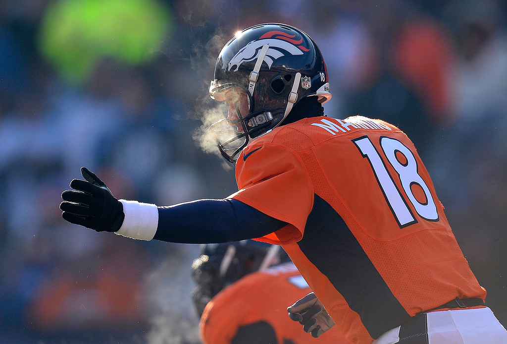 . Denver Broncos quarterback Peyton Manning (18) calls plays from the line in the first quarter.  2013. (Photo by John Leyba/The Denver Post)