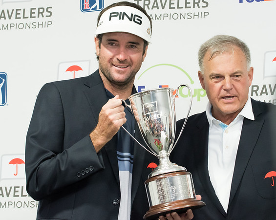 06/24/18 Wesley Bunnell | Staff The final day of The Travelers Championship at TPC River Highlands in Cromwell on Sunday June 24. Tournament Champion Bubba Watson finished with a -17 stands next to Executive Vice President and Chief Administrative Officer for Travelers Andy Bessette,