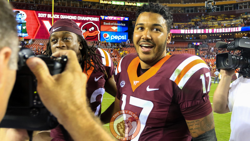 QB Josh Jackson gives off a face of disbelief as the Hokies celebrate postgame. (Mark Umansky/TheKeyPlay.com)