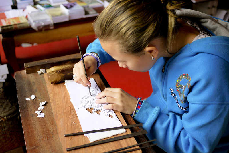 My niece learning how to use chisels to make the type of traditional designs and senticils used to decorate Laotian temples.