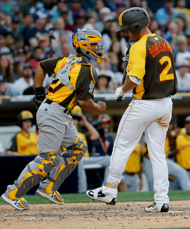 . U.S. Team Alex Bregman, of the Houston Astros, strikes out to end the game as catcher Francisco Mejia, of the Cleveland Indians, celebrates after the All-Star Futures baseball game, Sunday, July 10, 2016, in San Diego. (AP Photo/Lenny Ignelzi)