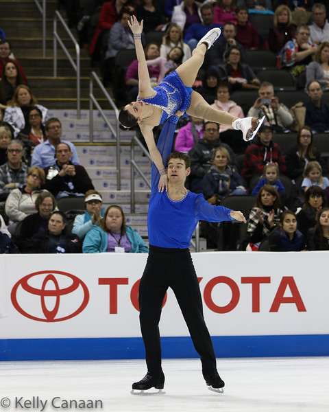 Brandon Frazier reaches high as partner Haven Denney holds on tight during their free skate. They won gold.