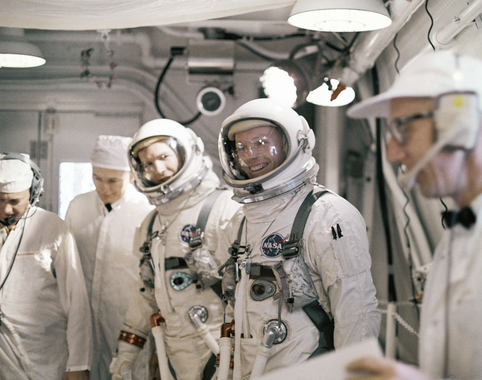 ". FILE - In this March 16, 1966 file photo, astronauts Neil A. Armstrong, fourth from left, and David R. Scott, third from left, arrive at Complex 19 for a simulated test in preparation for flight. The family of Neil Armstrong, the first man to walk on the moon, says he died Saturday, Aug. 25, 2012, at age 82. A statement from the family says he died following complications resulting from cardiovascular procedures. It doesn\'t say where he died. Armstrong commanded the Apollo 11 spacecraft that landed on the moon July 20, 1969. He radioed back to Earth the historic news of ""one giant leap for mankind.\"" Armstrong and fellow astronaut Edwin \""Buzz\"" Aldrin spent nearly three hours walking on the moon, collecting samples, conducting experiments and taking photographs. In all, 12 Americans walked on the moon from 1969 to 1972.  (AP Photo/File)"