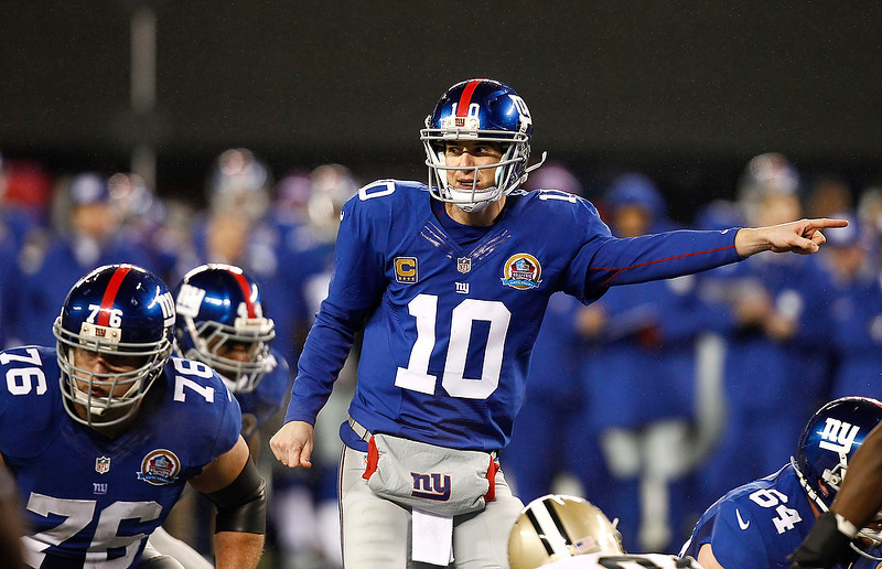 . Eli Manning #10 of the New York Giants gestures at the line during their game against the New Orleans Saints  at MetLife Stadium on December 9, 2012 in East Rutherford, New Jersey.  (Photo by Jeff Zelevansky/Getty Images)