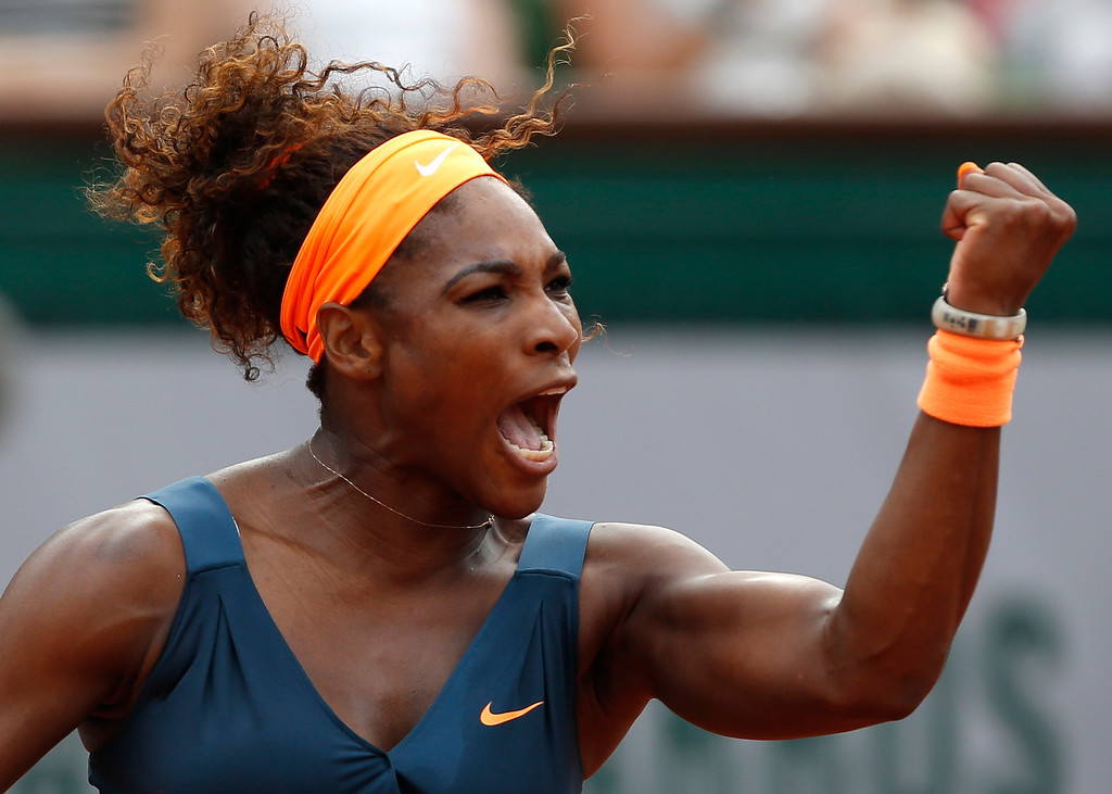 . Serena Williams, of the U.S,  clenches her fist as she plays Russia\'s Maria Sharapova during the Women\'s final match of the French Open tennis tournament at the Roland Garros stadium Saturday, June 8, 2013 in Paris. (AP Photo/Petr David Josek)