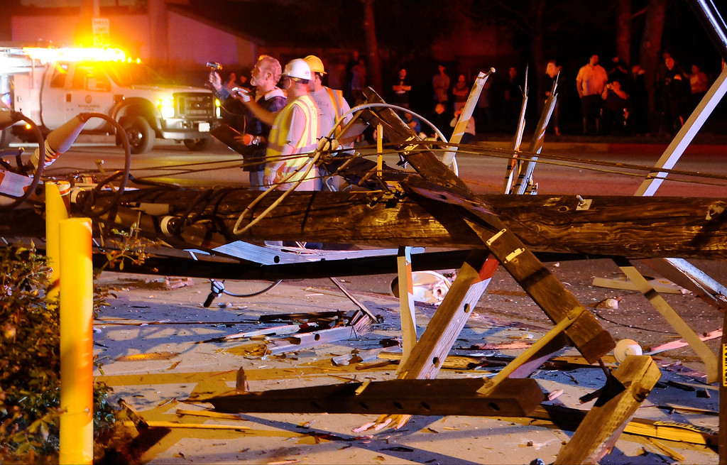 . March 23,2013.Mission Hills. LAPD and DWP on the scene after a driver lost control of their car and crash into a power poll Saturday night . The crash happen at Chatsworth St. and Chatsworth Dr. around 8:20pm and power around the general ares was knock out for many hours as DWP try to make the repairs. One person was taken to the hospital.  Photo by Gene Blevins/LA DailyNews