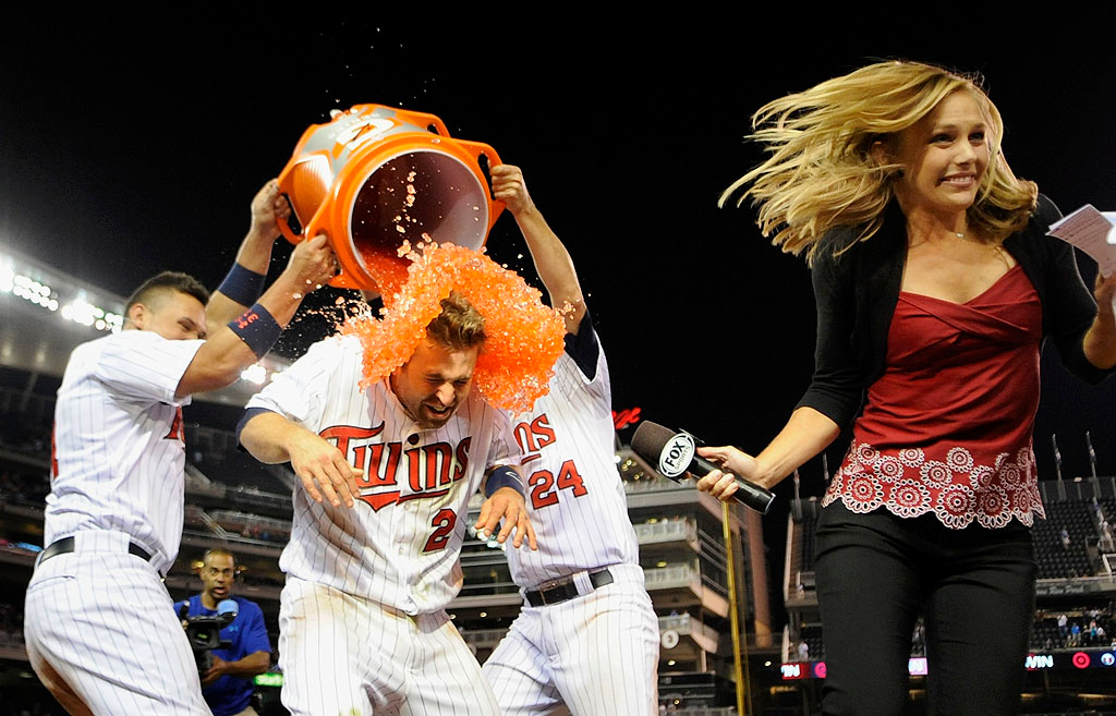 . Oswaldo Arcia, left, and Trevor Plouffe pour Gatorade on teammate Brian Dozier as he is interviewed after Dozier drove in the winning run in the 13th inning Friday, Aug. 2, 2013, at Target Field in Minneapolis. The Twins defeated the Astros 4-3. (Photo by Hannah Foslien/Getty Images)