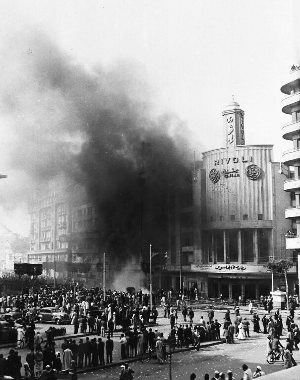 . View of the Rivoli Cinema, in Cairo, Egypt, Jan. 26, 1952, as it was burns during the rioting. A large crowd watches as firemen attempt to extinguish the blaze. (AP Photo)