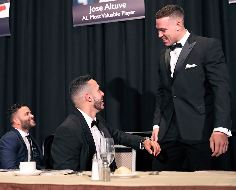 . American League Most Valuable Player Jose Altuve, left, of the Houston Astros, and Houston Astros Carlos Correa, center, chat with American League Rookie of the Year Aaron Judge of the New York Yankees during the New York Chapter Baseball Writers\' Association of America annual banquet in New York, Sunday, Jan. 28, 2018. (AP Photo/Kathy Willens)