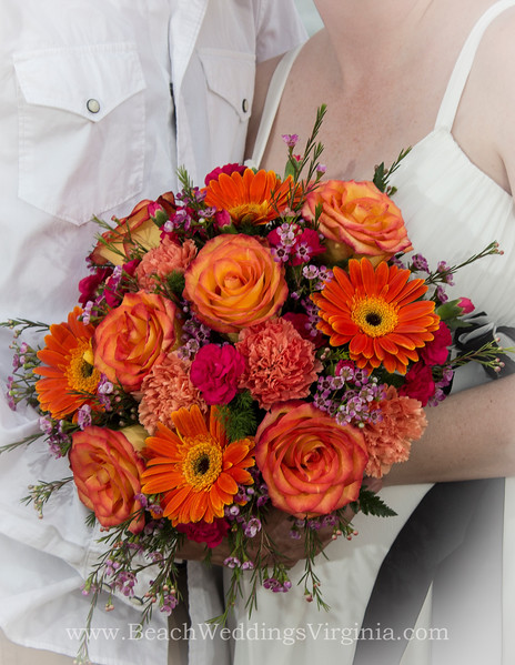 Orange gerber daisies, mixture of orange, hot pink and various shades of purple. Cascading style