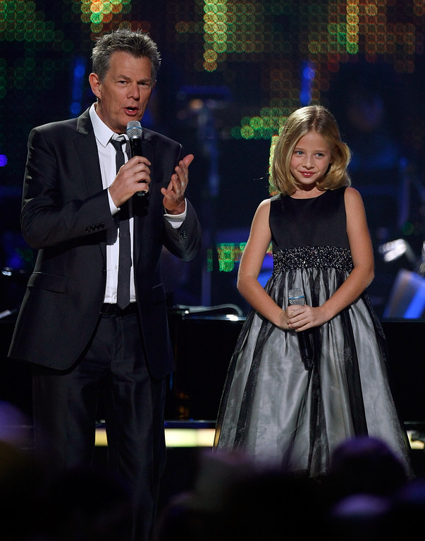 . LAS VEGAS - OCTOBER 15:  Producer/composer David Foster (L) talks with singer Jackie Evancho during the David Foster and Friends concert at the Mandalay Bay Events Center October 15, 2010 in Las Vegas, Nevada.  (Photo by Ethan Miller/Getty Images)