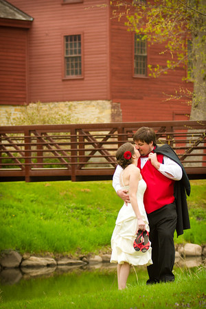 Bride and Groom steal a moment together in the garden at Belvidere Park for their spring wedding at the Belvidere Community Building Wedding near Rockford, IL. Rockford, Madison, Belvidere, Chicago, Wedding Photographers
