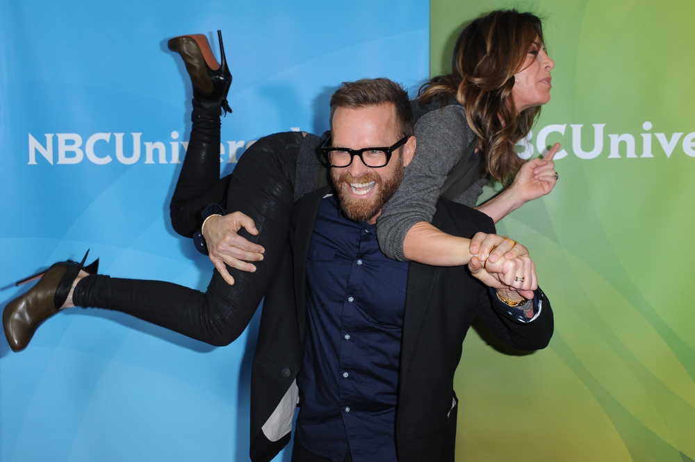 Description of . Bob Harper and Jillian Michaels, top, attend the NBC Universal Winter TCA Tour at the Langham Huntington Hotel, Sunday, Jan. 6, 2013, in Pasadena, Calif. (Photo by Richard Shotwell/Invision/AP)