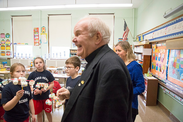 10/17/19 Wesley Bunnell | StaffrrMonsignor Daniel J. Plocharczyk, Pastor of Sacred Heart Church smiles as students in Mrs. Kerr's class at Sacred Heart School show him their science projects of making wind meters known as anemometers.