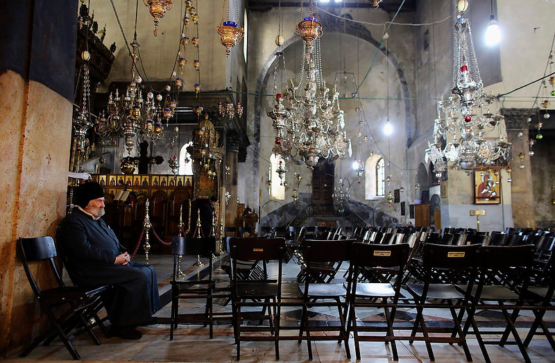 . A man sits inside the Church of the Nativity, the site revered as the birthplace of Jesus, ahead of Christmas in the West Bank town of Bethlehem on December 22, 2012. REUTERS/Ammar Awad