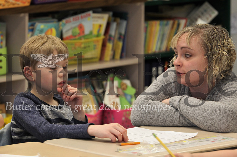 McQuistion Elementary first grader Dylan Bellis ponders Mother's Day letter ideas with teacher Rene Ruffner. Seb Foltz/Butler Eagle
