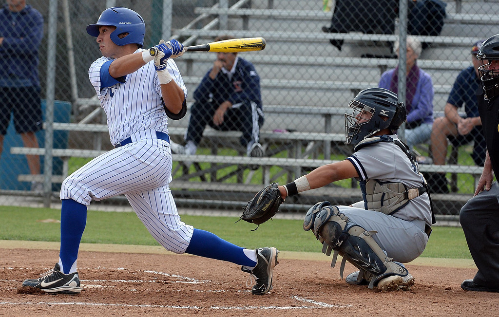 . Bishop Amat\'s Michael Palos watches his RBI bases loaded single in the first inning of prep baseball game against La Salle at Bishop Amat High School in La Puente, Calif., on Tuesday, May 6, 2014. (Keith Birmingham Pasadena Star-News)