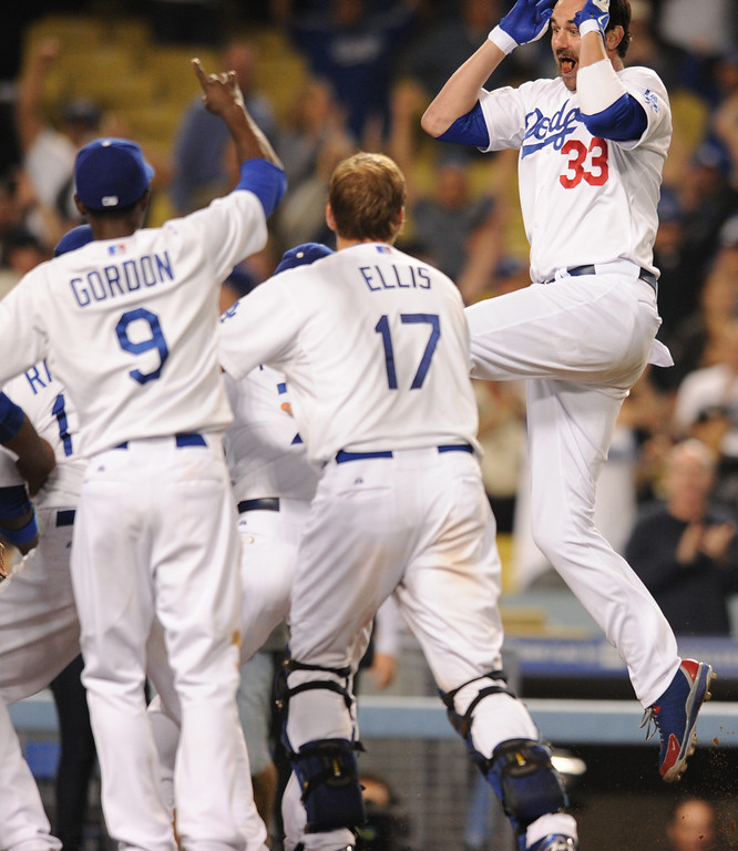 . Scott Van Slyke leaps into the air as he approaches home plate. The Dodgers defeated the Arizona Diamondbacks 5-3 after Scott Van Slyke hit a 2 run walk off homer in the 11 inning at Dodger Stadium in Los Angeles, CA. 9/10/2013. photo by (John McCoy/Los Angeles Daily News)