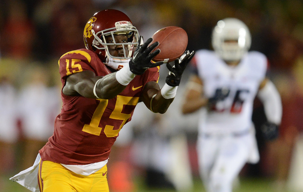 . USC\'s  Nelson Agholor #15 hauls in a 62-yard touchdown pass in the first quarter during their game against Arizona at the Los Angeles Memorial Coliseum Thursday, October 10, 2013. (Photo by Hans Gutknecht/Los Angeles Daily News)