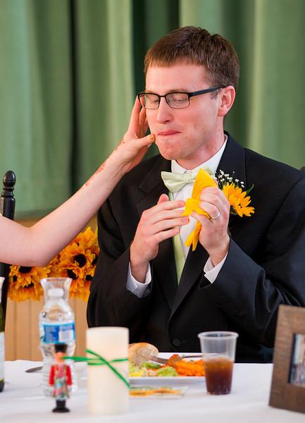 Bride cleaning grooms face.jpg