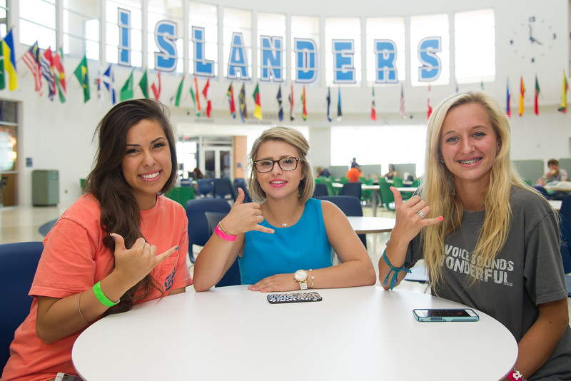 New students Lysette Lara(left), Autumn Balen and Erica Mynar show their Islander pride during the first day of orientation