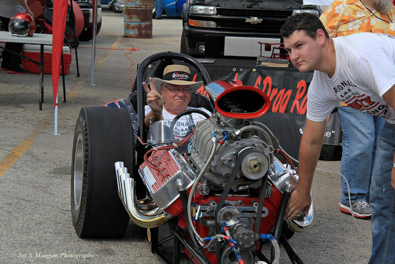 Bill Crosby drives the famous Scorpion fueler. He and Don Ross meticulously restored this car after having its authenticity verified by Bobby Langley himself. Its location was not known to the drag racing community for many years, but the car was eventually found only a few minutes from Langley's home near Ft. Worth.