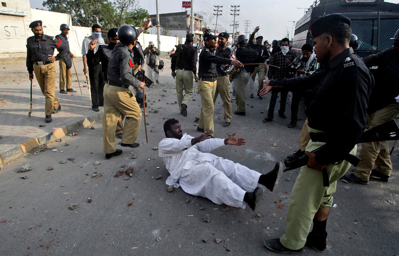. A Pakistani protestor is seen on the ground after being detained by police during clashes in Lahore, Pakistan, Sunday, March 10, 2013. Hundreds of Christians protesting the burning of their homes by a Muslim mob over alleged blasphemous remarks made against the Islam\'s Prophet Muhammad clashed with police on Sunday in eastern and southern Pakistan. (AP Photo/K.M. Chaudary)