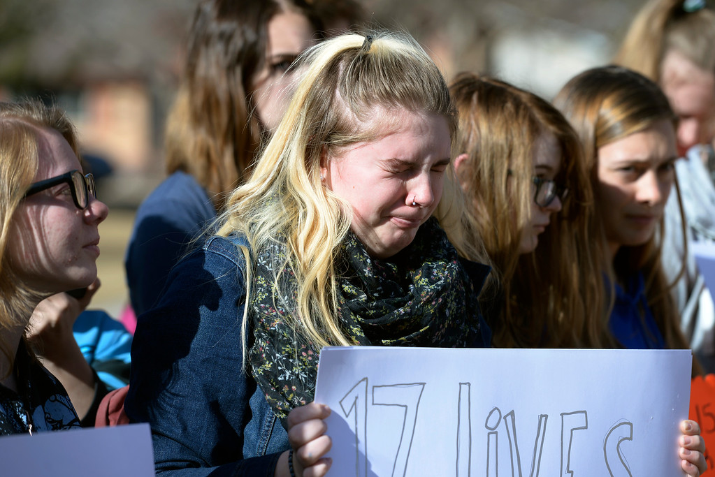 . Longmont High School junior Rosey McDowell cries as the names of the 17 Parkland, Florida victims are read aloud Wednesday morning during National Walkout Day. To view more photos visit timescall.com. Lewis Geyer/Staff Photographer March 14, 2018