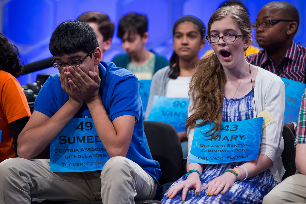 . Sumedh Garimella of Duluth, Ga., left, and Mary Elizabeth Horton of West Melbourne, Fla., wait for their turn during the semifinal round of the National Spelling Bee, on Thursday, May 29, 2014, in Oxon Hill, Md. (AP Photo/ Evan Vucci)