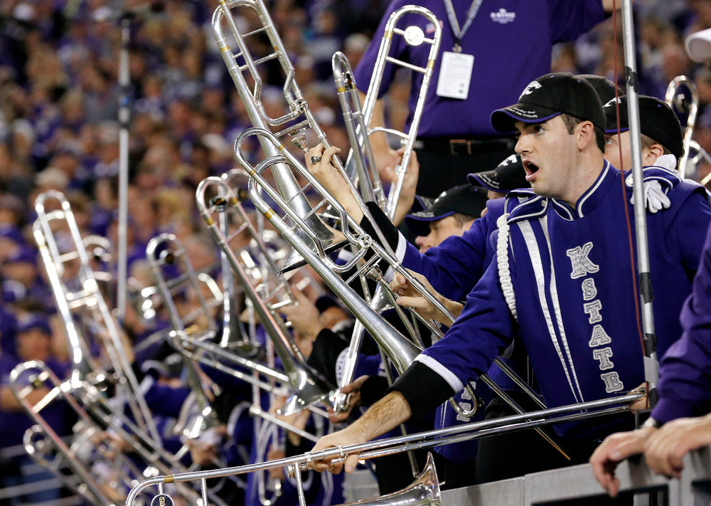 Description of . The Kansas State band performs during the first half of the Fiesta Bowl NCAA college football game against Oregon, Thursday, Jan. 3, 2013, in Glendale, Ariz. (AP Photo/Ross D. Franklin)
