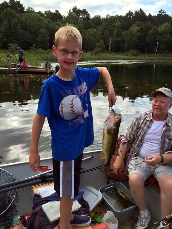 ". Jack Frigstad, 8, caught this 5-pound largemouth bass Aug. 20 while fishing Star Lake in Crosslake. The pair is reported to have fished fished all week and caught many fish, but this was Jack\'s biggest - ""a catch of a lifetime\""� until next year. (Photo courtesy Karen Frigstad)"
