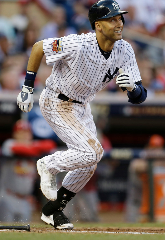 . American League shortstop Derek Jeter, of the New York Yankees, singles during the third inning of the MLB All-Star baseball game, Tuesday, July 15, 2014, in Minneapolis. (AP Photo/Jeff Roberson)