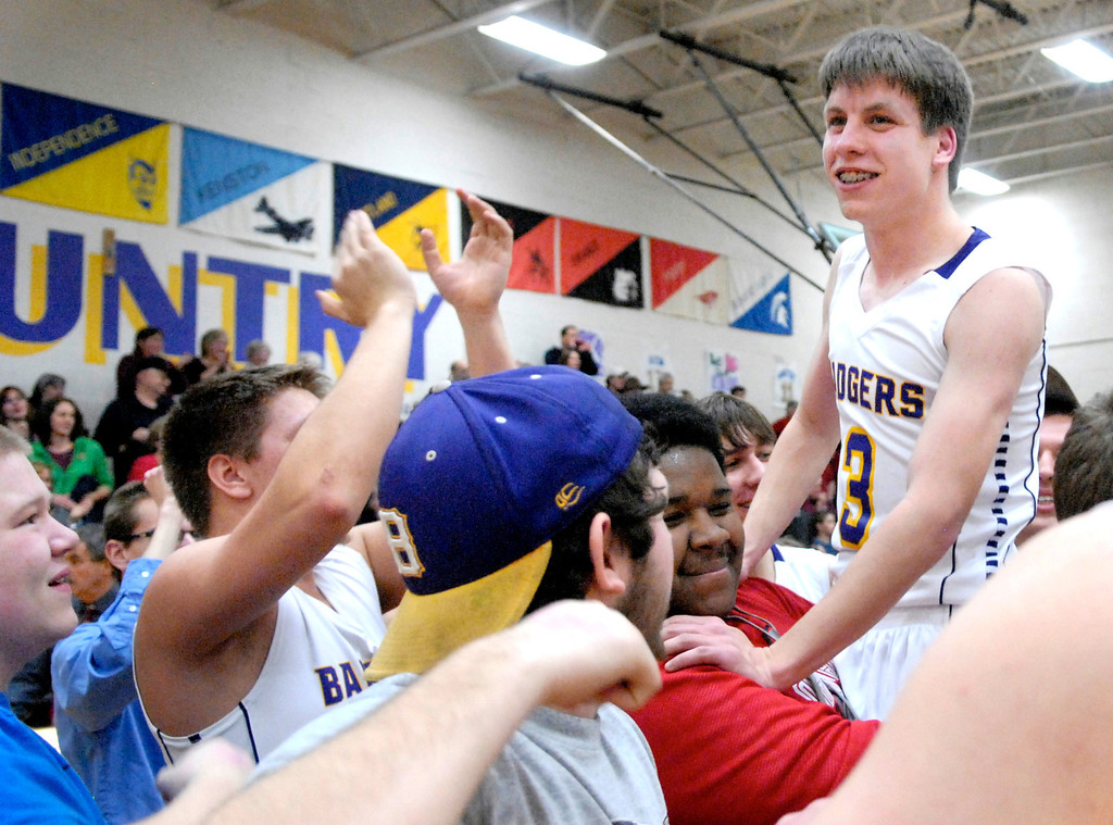 . Jeff Forman/JForman@News-Herald.com Friends and teammates lift up Luke Freiling after the game.