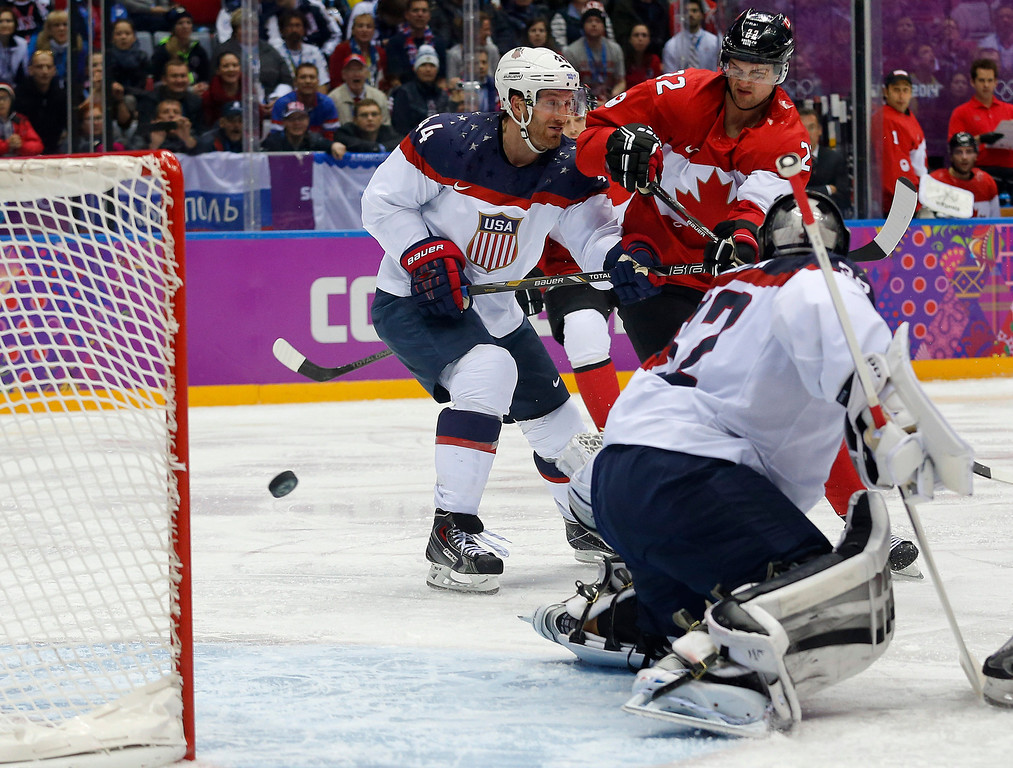 . Canada forward Benn Jamie, right, shoots and scores against USA goaltender Jonathan Quick during the second period of a men\'s semifinal ice hockey game at the 2014 Winter Olympics, Friday, Feb. 21, 2014, in Sochi, Russia. (AP Photo/Julio Cortez)