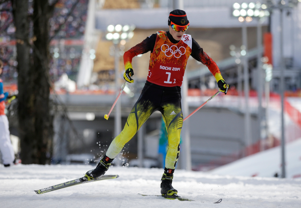 . Germany\'s Eric Frenzel competes during the cross-country portion of the Nordic combined Gundersen large hill team competition at the 2014 Winter Olympics, Thursday, Feb. 20, 2014, in Krasnaya Polyana, Russia. (AP Photo/Gregorio Borgia)