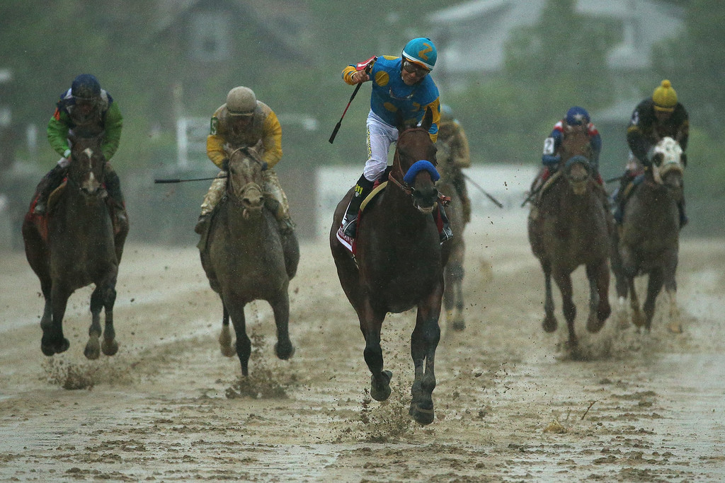 . American Pharoah #1 ridden by Victor Espinoza crosses the finish line to win the 140th running of the Preakness Stakes at Pimlico Race Course on May 16, 2015 in Baltimore, Maryland.  (Photo by Patrick Smith/Getty Images)