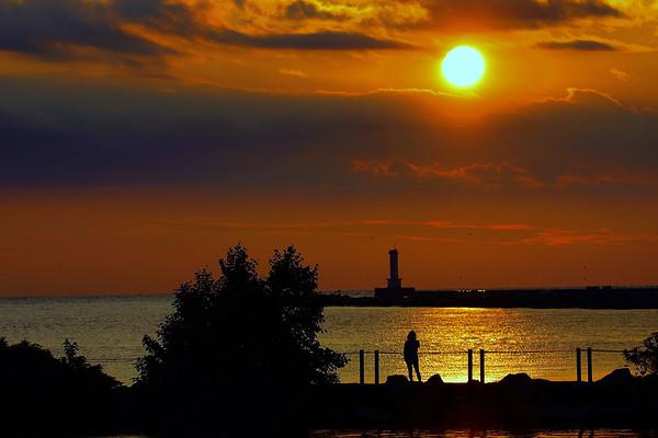 Lady on Wlakway Watching Sunset